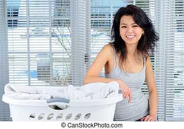 Happy Housework - Pretty Chinese Girl With Long Hair Doing...