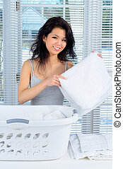 Homemaker - Pretty Chinese Girl With Long Hair Doing Laundry...