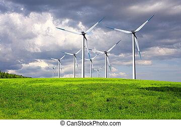 Windmills on summer field