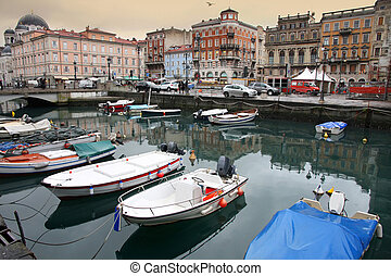 Trieste, Italia - Canal grande and Port in the city,...