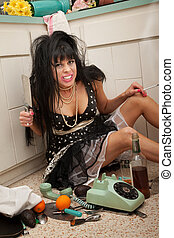 Angry Woman - Angry woman on kitchen floor holds butcher...