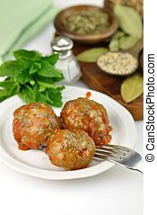 meatballs with tomato sauce  in a white plate