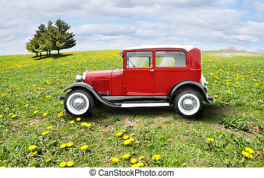 retro car - red retro car on a green field
