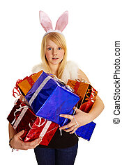 Young blonde in a bunny suit with gifts - A young blonde in...