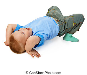 Child tries to do a gymnastic stance on floor - The child...