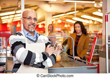 Grocery Store Cashier - Portrait of a grocery store cashier...