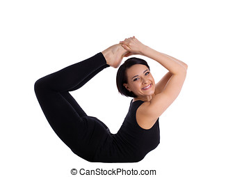 woman back bends yoga - bow pose and smile - young woman...