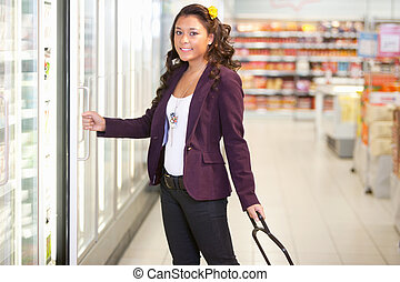 Cold Food Supermarket - Portrait of a young woman opening...