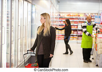 Supermarket Grocery Store - Woman in shopping mall looking...