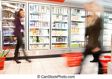 Busy Supermarket With Motion Blur - Blurred motion of people...