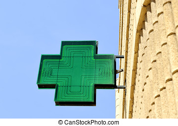 Sign at pharmacy - Green sign at pharmacy against clear blue...