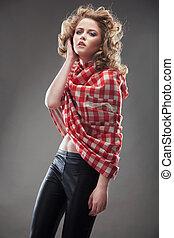 Studio photo of a pretty young woman