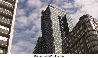 Condos with timelapse clouds. - Condominiums and office...