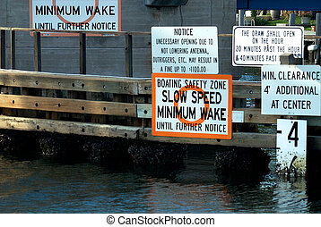 Profusion of signs on a bridge of the intercoastal waterway.