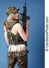 Sexy soldier with assault rifle