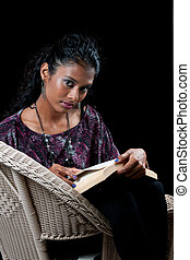 beautiful indian woman reading - beautiful woman of east...