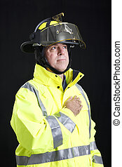 Reverent Firefighter - Firefighter with his hand over his...