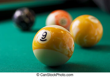 billiards - The game of billiards on a table with green...