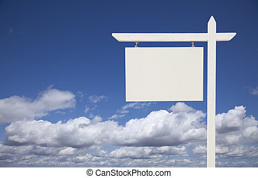 Blank White Real Estate Sign Over Sky and Clouds