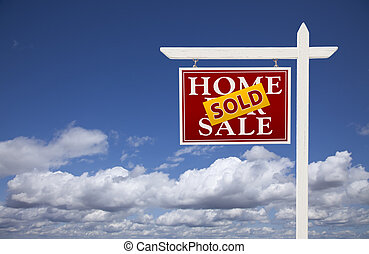 Red Sold Home For Sale Real Estate Sign Over Clouds and Sky
