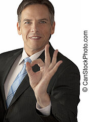 Businessman Giving OK Sign