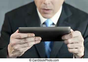 Businessman Concerned By Tablet
