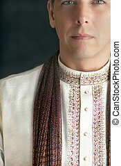 Man in Traditional Indian Clothing - A close-up shot of a...