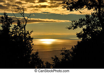 Golden sunset. - Golden sunset at Turnagain Arm near...