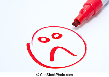 sad face drawn on white with red pen showing customer...