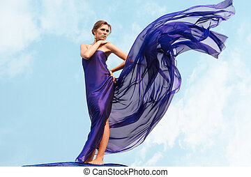 Luxurious woman - Charming woman folded in dark blue chiffon...
