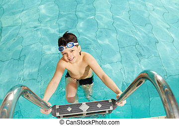 Boy in pool - Photo of happy lad in pool smiling at camera