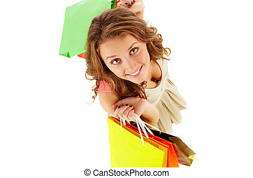 Consumer - Above angle of a girl with paper bags looking at...