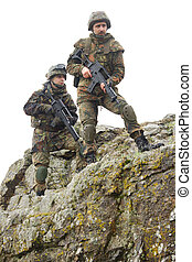 Soldiers moving on mountain with guns - Two heavy equiped...