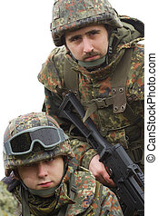 Portrait of two equiped soldiers