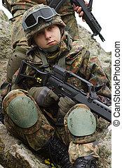 Portrait of young soldiers in helmet