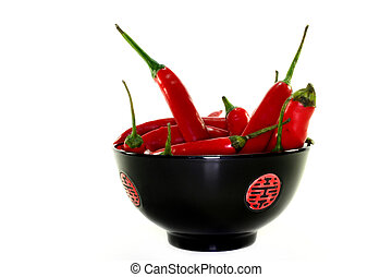 Chilli peppers - fresh red chili peppers in Asian bowl