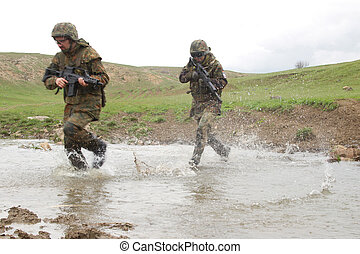Soldiers running across the water - Military men crossing...