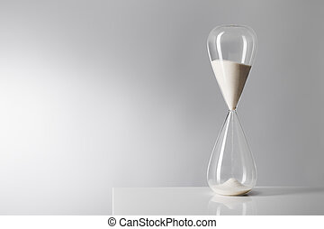 Sands of time - Studio photo of a hourglass on reflective...
