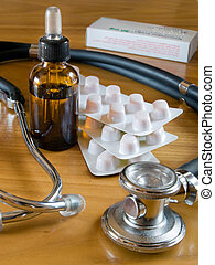 stethoscope and blister pills wiyh bottle dropper