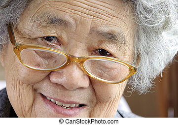 happy grandmother look at photographer