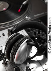 Dynamic headphones laying on mixing controller - Big stereo...