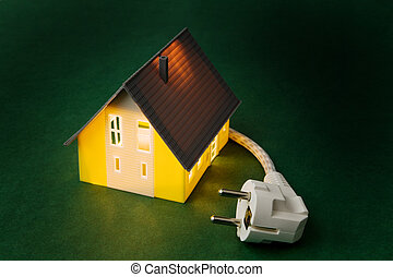 a house with power plug - An illuminated house with power...