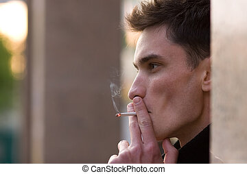 Smoking young adult man