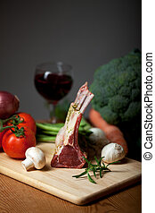 raw lamb meat and assorted vegetables