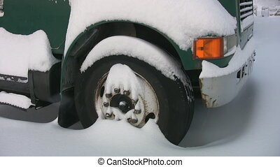 Big snow truck. - Big truck covered in snow. Two shots. Very...
