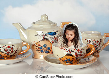 Miniature girl on tea party - Tea party with antique tea...