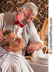 Barber cutting mustache - Barber cutting the mustache of a...