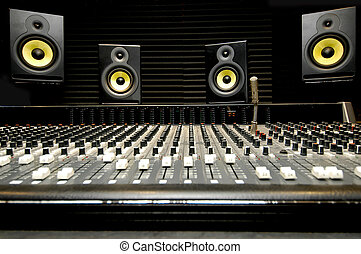 Mixing desk with speakers - Low angle shot of a mixing desk...