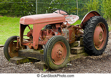 Vintage Farm Tractor - A rusty old farm tractor sits alone...