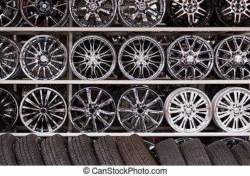 alloy car wheels wall - wall of alloy car wheels and...